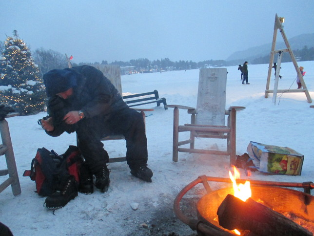 Warmed by the outdoor fire on Lake Placid